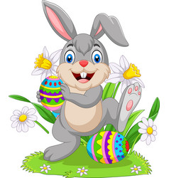 easter bunny with decorated eggs vector image