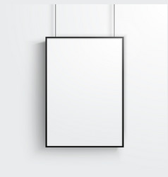 white poster with black frame mockup on grey wall vector image
