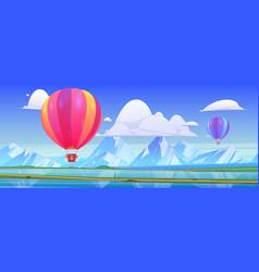 Hot air balloons fly above mountain valley vector