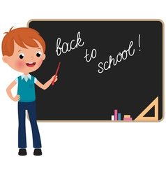 Schoolboy standing at the blackboard vector