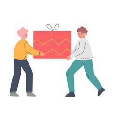two teenage boys carrying huge present box joyful vector image