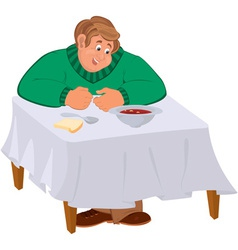Happy cartoon man sitting with soup at the table vector image