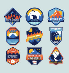 Set of badges with mountain peaks and forest camp vector
