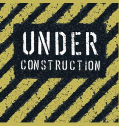 under construction message on asphalt texture vector image