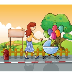 A mother strolling with stroller vector