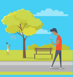 boy with smartphone on walk in park out of town vector image