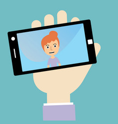 womans hand holding smartphone with self portrait vector image