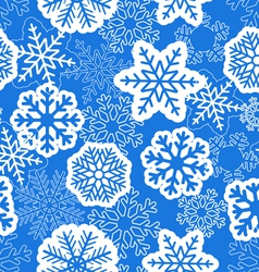 Blue seamless christmas background with snowflakes vector image