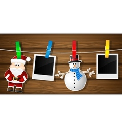 Blank photo frames snowman and Santa on a vector image