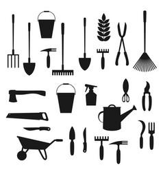 Garden tools shovel rake wheelbarrow spade vector