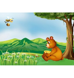 A bear sitting near a tree vector image vector image