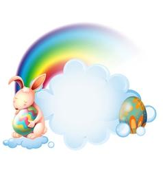 A bunny hugging an easter egg near the rainbow vector image vector image