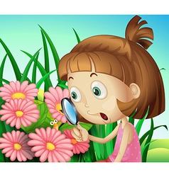 A girl using a magnifying glass at the garden vector