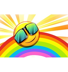 A rainbow with a smiling sun vector