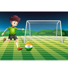 An athlete kicking ball with flag india vector