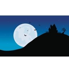 Silhouette of castle in hills halloween vector