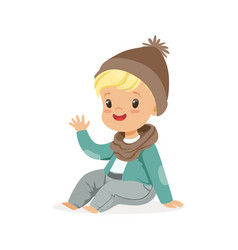 Cute little blonde boy in a brown hat and scarf vector