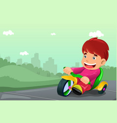 Boy riding tricycle vector