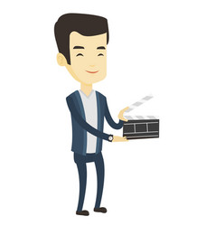 Smiling man holding an open clapperboard vector