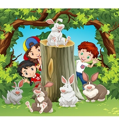 Children in the jungle with rabbits vector
