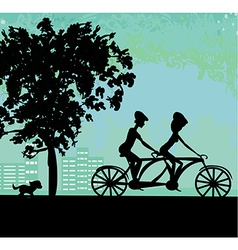 couple biking in the city vector image