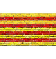 Grunge flag of Catalonia on a brick wall vector image