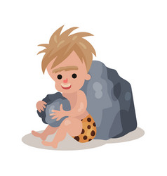 stone age cave boy sitting and playing stones vector image