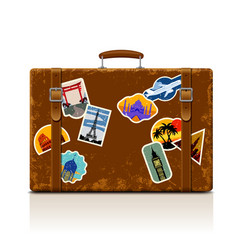 vintage brown threadbare suitcase with collection vector image vector image