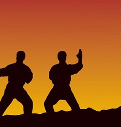men are engaged in karate on a yellow background vector image