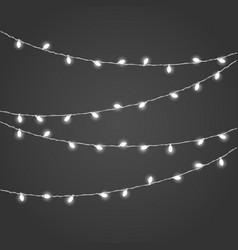 different white lighting garland set on dark vector image