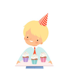 Little boy wearing birthday hat carrying cupcakes vector