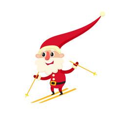 Cute santa claus skiing cartoon vector