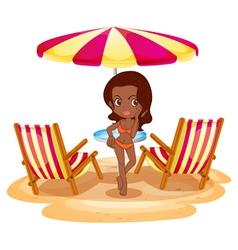 A tan lady at the beach near the beach umbrella vector image vector image
