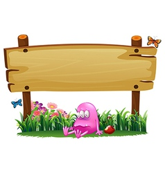 A poisoned pink monster under the empty wooden vector image