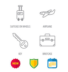 suitcase on wheels key and airplane icons vector image