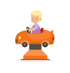 cute blonde little boy riding on an orange car vector image vector image