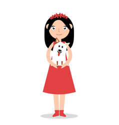 happy girl holding a dog in her arms and smiling vector image
