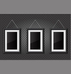 three black empty pictures on metal perforated vector image