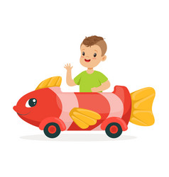 Cute little boy riding on toy fish car kid have a vector