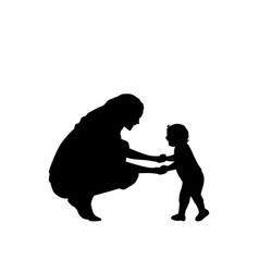 silhouette mother holding little son hands vector image