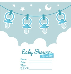 Blue baby shower invitation with pacifiers vector