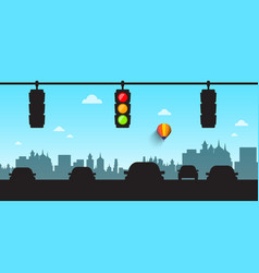 Car silhouettes with traffic lights and skyline vector