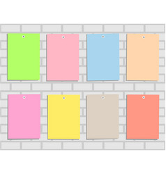 Eight multicolored paper on brick wall vector