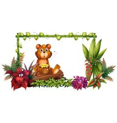 A bear above a trunk in the garden vector image vector image