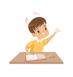 Naughty boy ripping pages of book and doing paper vector