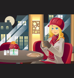 Winter woman drinking coffee vector