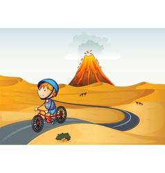 A boy riding a bike in the desert vector image