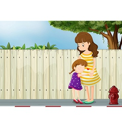 A mother and her daughter near the fence vector
