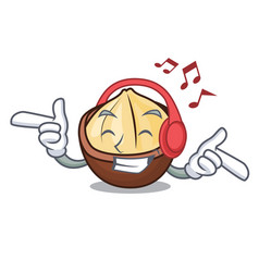 Listening music macadamia mascot cartoon style vector