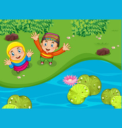 Muslim boy and girl waving hands in park vector